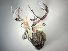 """Comtempary 3D Puzzle Collectible Deer Head by ESPYColorImaging  Contemporary collectible art ready to be hang on your wall! - Die cut from 1/4"""" PVC with vintage imagery directly printed on. - Easy to assemble (instruction included), no glue or tools necessary with two holes on reverse for hanging. Width: 19"""" (48.26 cm) Height: 25"""" (63.5 cm) Depth: 20"""" (50.8 cm) Weight: 7lbs Package Size: 24"""" x 19"""" x 3""""  Price: $120 + shipping & handling  Please contact us @ espycolorimaging@gmail.com"""