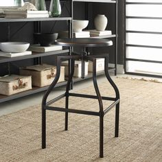 With a classic silhouette and sleek copper finish, our modern stool is crafted of hand-forged metal. It features a swivel mechanism that adjusts its height to bar or counter level.