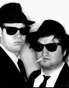 """The Blues Brothers is a 1980 American musical comedy film directed by John Landis and starring John Belushi and Dan Aykroyd as """"Joliet"""" Jake and Elwood Blues, c Blues Brothers 1980, John Landis, Film Movie, Movies, At Home Movie Theater, Comedy Films, Two Men, Blues Music, Male Poses"""