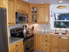 Maple wood, with a honey stain by Oceanside Cabinets