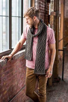 """No matter how many cabled I scarves make, I always want more. I guess I'm somewhat of a cable glutton. I think cabled accessories add both comfort and sophistication to a man's look. This scarf features two large, plaited rib cables that periodically interlock with one another over the length of the scarf. Instructions for …"