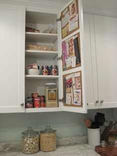 Inside cabinet cork board - so great for those little pieces of paper that collect on the counter! I'm totally doing this!