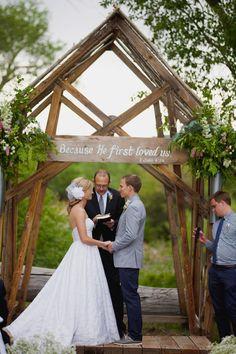 Rustic handmade wedding arbor. #arbor #handmade #outdoorwedding #bibleverses http://www.weddingchicks.com/2013/11/01/burlap-and-lace-wedding/