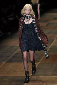 Collections - SHOWstudio - The Home of Fashion Film: Saint Laurent Paris Fashion Week 2013: YSL was inspired by the grunge of the 1990s, with the plaid button down oversize shirt and the oversize shift dress. The runway piece seemed like it was taken from the Thrift store and made chic.