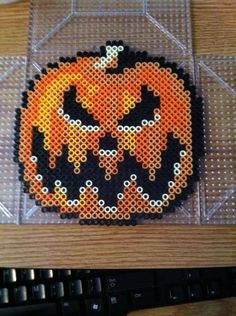 Pumpkin - Halloween perler beads by Khoriana on deviantART - Pattern: http://www.pinterest.com/pin/374291419002326947/