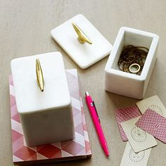 Cute for organizing the little things: marble cleat boxes. West Elm.