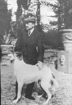Gabriele D'Annunzio with one of his dogs