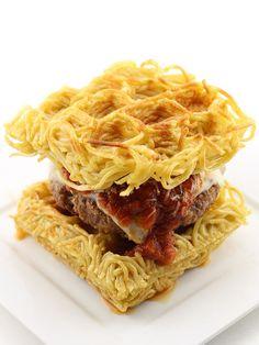 The Waffled Spaghetti Bun Burger: buttered spaghetti on waffle iron top with Italian sausage patty, marinara, and mozzarella cheese