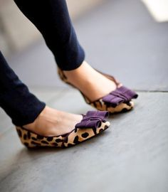 I love the purple bow on these leopard flats