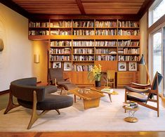 Finn Juhl Chieftain chair, right, an Isamu Noguchi Rocking stool and a pair of George Nakashima Slab Coffee tables. Rare and early Warren McArthur side chair and Vladimir Kagan sofa. Private residence in Austin, Texas - architecturaldigest Home Library Rooms, Home Library Design, Home Libraries, House Design, Mid-century Interior, Interior Architecture, Interior Design, Danish Interior, Mid Century House