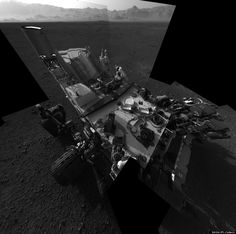 Mars Rover Self-Portrait  'Still Life with Rover'  This full-resolution self-portrait shows the deck of NASA's Curiosity rover from the rover's Navigation camera. The back of the rover can be seen at the top left of the image, and two of the rover's right side wheels can be seen on the left. The undulating rim of Gale Crater forms the lighter color strip in the background. Bits of gravel, about 0.4 inches (1 centimeter) in size, are visible on the deck of the rover.