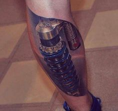 We were almost fooled into believing this man's leg was actually made of metal. #InkedMagazine #3D #realistic #tattoo #tattoos #Inked #Ink