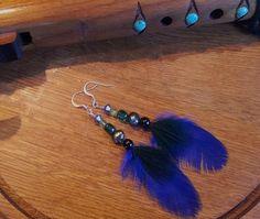 Bright blue and black feathers. (Oo La La collection)