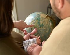 Globe photo prop for newborn baby photography | Get more ideas and inspiration on the Mohawk Home blog | Picture Perfect Photo Props for Newborns, Toddlers and Big Kids