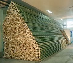 """Bamboo Booth' was exhibited in the """"Vietnam Architecture Exhibition 2012″, held in Hanoi for 5 days in April, 2012.Bamboos were chosen to express Vietnamese architecture culture. To cope up with the short construction time period, bamboos are placed straightly like brickwork to create massive wall, floor and roof in a minimalist manner.The Company calls it """"bamboo masonry"""", or a quasi log house structured by bamboos."""