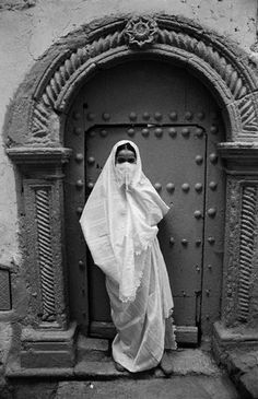 December 1979, Algiers, Algeria — A woman wearing traditional dress in the Casbah of Algiers.