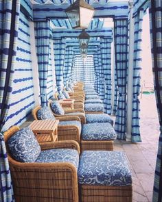 Gorgeous blue and white and wicker seating for a sunny pool!