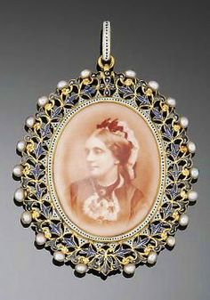 A LATE 19TH CENTURY GOLD, ENAMEL AND PEARL PENDANT, BY CARLO GIULIANO The black, blue and white piqué enamel openwork floral wreath design oval border enclosing portraits of a lady and a gentleman, to a white and black enamel piqué enamel pendant loop, circa 1880 The pendant loop with with maker's mark CG