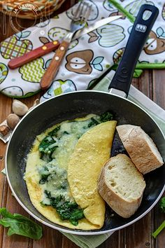 Omelet with spinach and scrambled eggs with cracklings