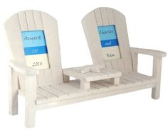 "Sandy Beach Chair Double Photo Frame Photo Size: 2"" x 3"" Size: 6""H x 10""W x 4""D Evoke memories of sitting on the shore, toes in the sand and the sound of waves crashing by displaying pictures of your beach vacation in this Bride & Groom 'Seat for Two' Sandy Bench Picture Frame. This frame is made of the perfect wood to look identical to a full size bench on the beach. This double chair picture frame offers the unique ability to display two pictures at once against each of the…"