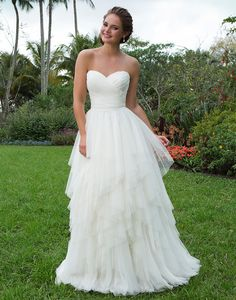Sweetheart sweetheart style 6119 Sweetheart ruched English net at bodice, cummerbund at natural waistline and handkerchief layered skirt of English net create this ball gown that is perfect for relaxed, charming brides.