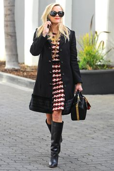Reese Witherspoon in a black coat, patterned dress and knee-high black boots - click ahead for more celebrity winter outfits!