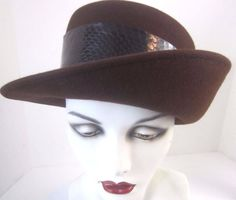 """Frank Olive was a designer to the stars circa 1960's, and was known to say: """"A hat is basically a prop; it gives you a moment of joy, mystery, fantasy."""" Here's a piece of his original mystery - cocoa brown sculptural cloche hat, alligator wide band trim. Beauty!"""
