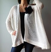 The oversized cardigan, with its sleeves beginning at elbow, drapes beautifully into a high-low hemline and is flattering for all body shapes. With ribbed cuffs and borders, and worked seamlessly in a simple mesh stitch pattern, this cardigan is perfect for the beginners, as well as for the experienced to crochet while watching TV.