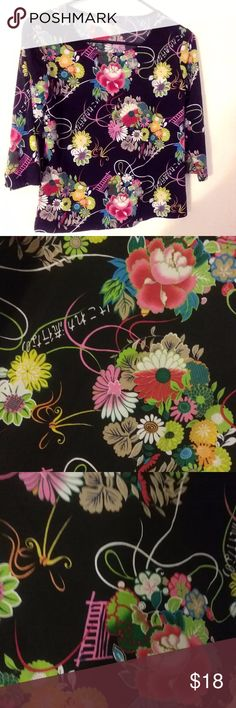 Brittany Black Mandarin Floral 3/4 Sleeve Stretch This is a beautiful designer Brittany Black Mandarin Floral 3/4 Sleeve Stretch Top Black with Multiple Colors Size M. It's pre loved with no stains, or damage. See pictures to see the lovely pattern up close! Brittany Black Tops Blouses