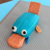 I thought this looked like a blue alien with a flat tail throwing up an orange blob but it's actually Perry the Platypus in cake form. The things you learn on the internet.