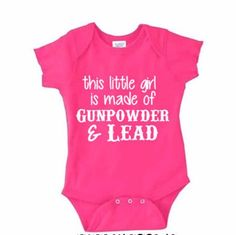 Gunpowder and Lead. This little girl is made of gunpowder & lead printed on a Rabbit Skins brand baby onesie. Features lap-shoulders and 3 snaps at the bottom. Sizing help is located in product photos