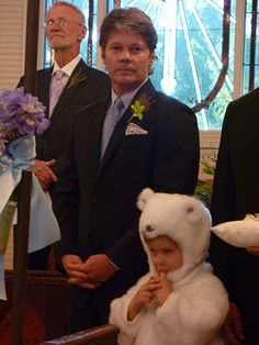 "the ring ""bear"" at a childhood friend's wedding. he was so excited when he was told he was going to be the ring bearer because he would get to dress up as a bear! so cute!"