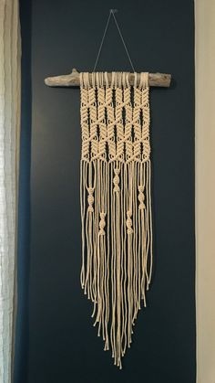 This macrame wall hanging was handcrafted on a piece of driftwood found along the shores of Lake Ontario. It is made of 100% cotton rope and natural wood. The hanging measures approximately 19.5 wide including the driftwood (10.5 without) and 58 long including the string to hang (46 without).  ***THIS WALL HANGING HAS SOLD*** If you purchase this listing, you are placing a custom order for a replica of this particular wall hanging design. It will hang from a piece of driftwood that is…
