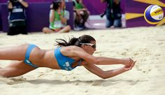 Marta Menegatti of Italy digs out a ball during a beach volleyball match against Spain at the 2012 Summer Olympics, Saturday, Aug. in London. Women Volleyball, Beach Volleyball, Never Back Down, 2012 Summer Olympics, Sports Figures, Cute Guys, London, Bump, Bikinis
