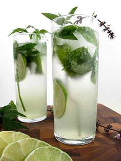 Thai Basil Mojito    2 lime wedges  10 Thai basil leaves  2 ounces white rum  1 ounce simple syrup, recipe follows  soda water  Thai basil sprig, for garnish    In a cocktail shaker, muddle together lime wedges, Thai basil leaves, rum, and simple syrup with crushed ice. Pour into a chilled highball glass. Top off with soda water. Garnish with Thai basil sprig. Yield: 1 drink.