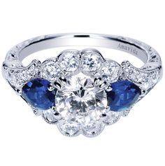 Sapphires add a modern twist to this Amavida Engagement Ring. This stunning Gabriel & Co. engagement ring was designed to stand out above anything! The diamonds and sapphires work so well together making each other pop and brighten.