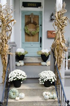 Add a touch of sophistication to your porch by forgoing the classic reds, oranges, and yellows that are so closely associated to fall, for decorations in light blues and whites.