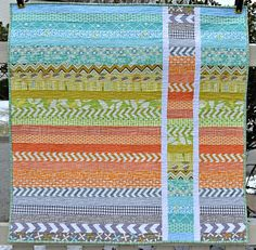 Strip and Flip baby quilt by sewcraftyjess, via Flickr