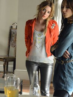 Even when she's wearing jeans and a tee, Hanna always glams up her look. The subtle sparkle on her silver skinnies is balanced by her boho blouse and bright orange moto jacket! MORE: 8 Ways To Wear Holographic Pieces   - Seventeen.com