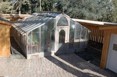 Extra large, custom 16x20 Garden Deluxe greenhouse. The redwood is stained gray.
