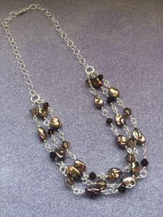 A personal favorite from my Etsy shop https://www.etsy.com/listing/268791515/brown-freshwater-pearl-and-swarovski