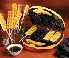 Cook up some delicious breakfast treats in a flash with this toast and waffle sticks maker! It features interchangeable plates so you can make 5 waffle sticks and 5 toast sticks per batch. Use the included sticks to make then fun. Waffle Pops, Waffle Bar, Waffle Iron, Food Trucks, Cooking Gadgets, Cooking Recipes, Waffle Sticks, Waffles On A Stick, Mini Pastries