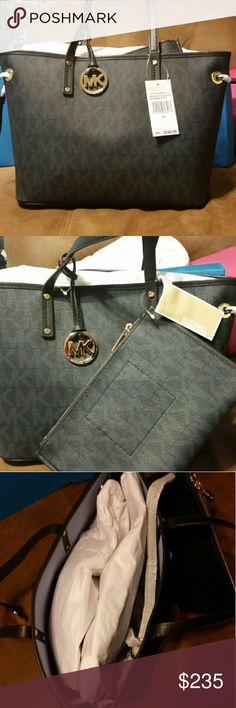 Michael Kors new with tags 2 piece handbag set Michael Kors handbag set with 2 piece. Navy in color. Very beautiful and authentic. Brand new with tags. Jet set reversible tote. Baltic blue. MD reversible tote. Michael Kors Bags Totes