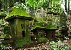 Small representations of Shinto shrines (Buddhist cemetery)