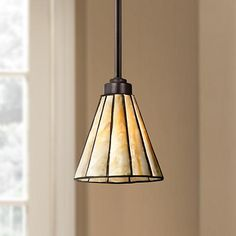 A classic reimagined, this contemporary bronze mini pendant features a cone shade accented with gorgeous tiffany style honey glass.