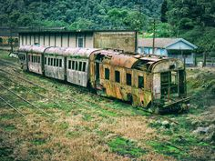 The remains of a British railway rusting in the jungle mist of a Brazilian mountainside.