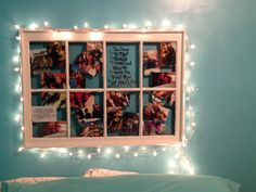 Old window made into picture frame with white strand lights, using in place of a headboard for my teenage daughter