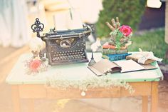 Vintage wedding welcome table antique typewriter books and more | OneWed.com