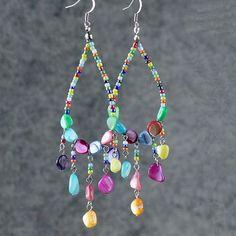 Cette créoles de lustre coloré sont faits à la main à laide de Shell, perles de la mer. Livraison gratuite dUS. Les clients ayant acheté cet article dit : -« Ils vont très bien avec un collier que jai déjà. » -Love ces boucles doreilles. Excellent achat. Les couleurs sont parfaites.