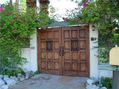 This lightly distressed door has just the right touch to give this front yard a sense of privacy and character. Learn more about landscaping for privacy here: http://www.landscapingnetwork.com/landscaping-ideas/privacy/# Photo by Maureen Gilmer in Morongo Valley, CA.